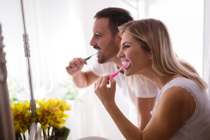 couple brushing teeth