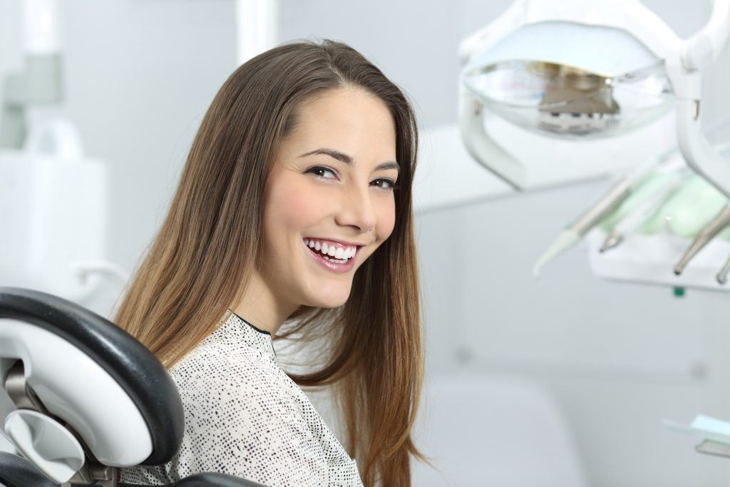 B20-smiling-young-woman-in-dentist_s-chair