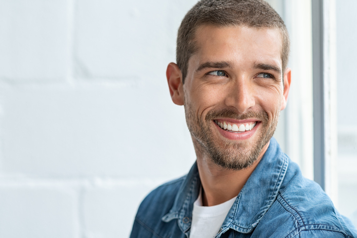 man smiling looking other wayperiodontics Orlando FL