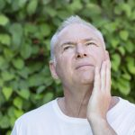 man in need of periodontal treatment orlando fl